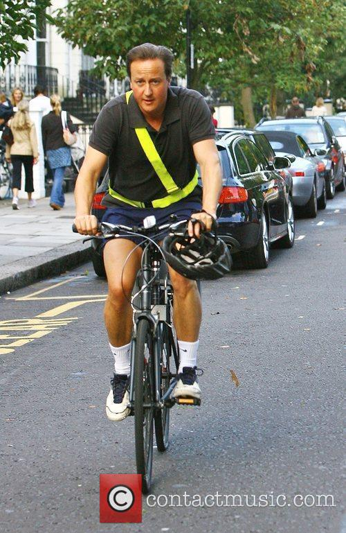 Conservative Party leader, David Cameron makes his way...