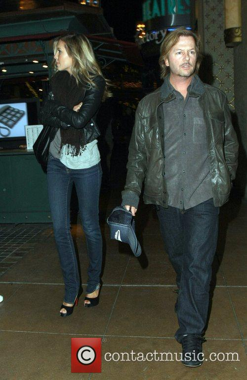 Actor David Spade  with a female friend...