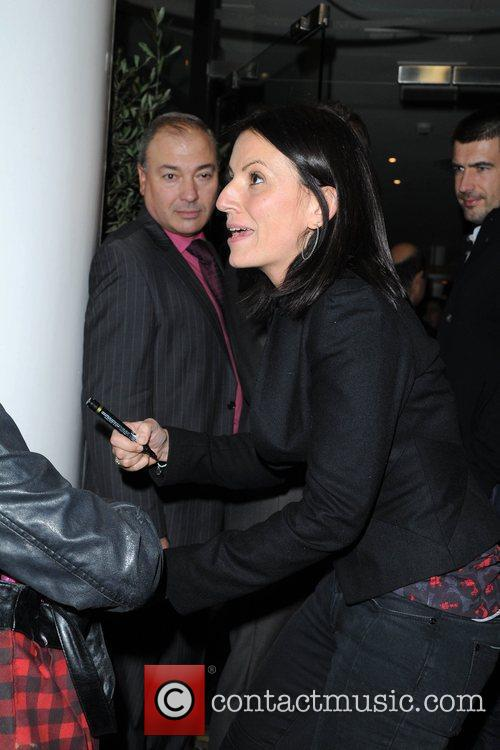 Davina McCall signs an autograph for a fan...
