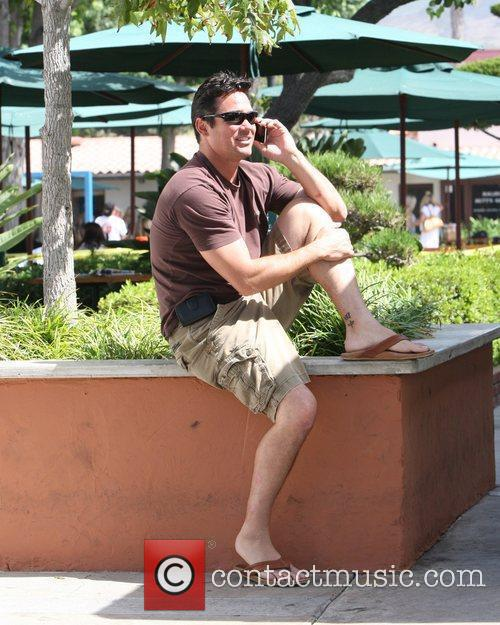 Dean Cain  talking on the phone as...