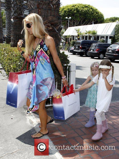 With her daughters Sam and Lola shopping at...