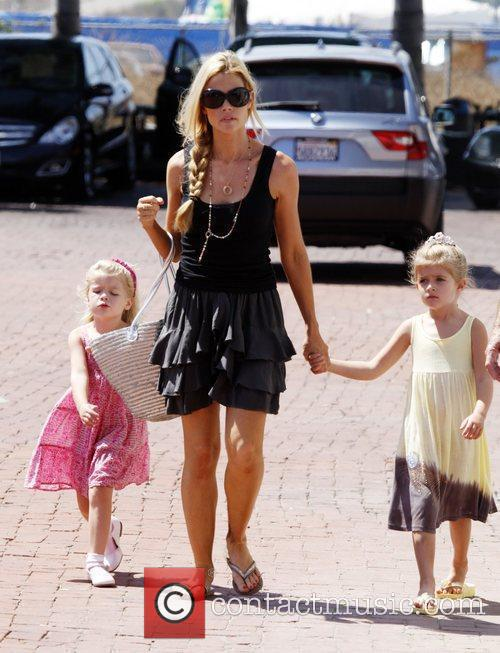 Denise Richards takes her daughters to a park...
