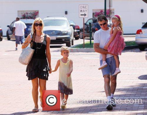 Denise Richards and her father take her daughters...