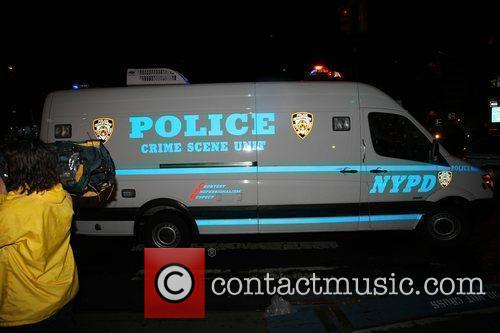 A police crime scene unit van outside the...