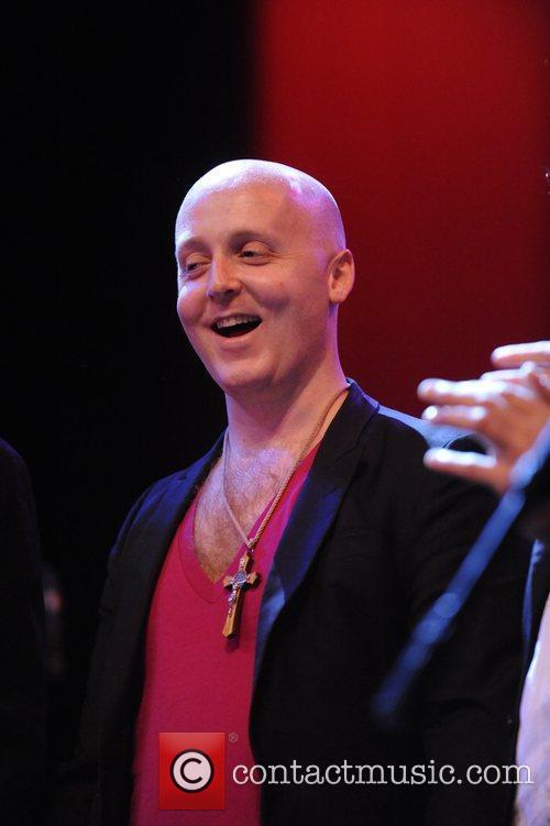 James McCartney performs live with his band as...