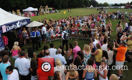 Fans queue at Katie Price's tent at the...