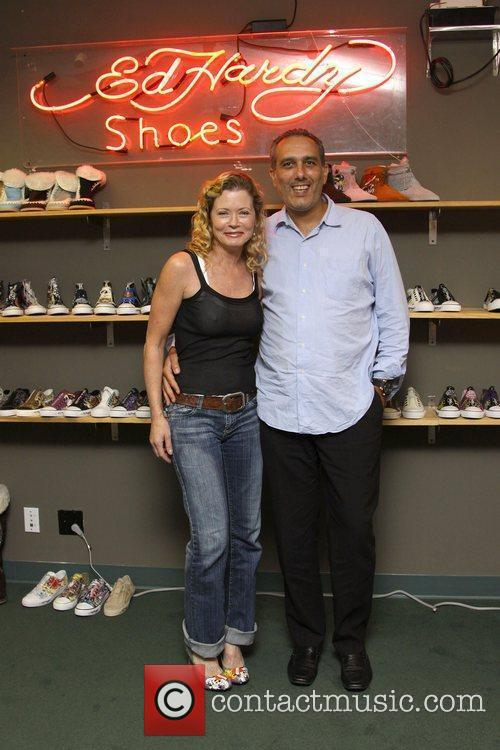Visits the Ed Hardy Shoe Warehouse in Los...