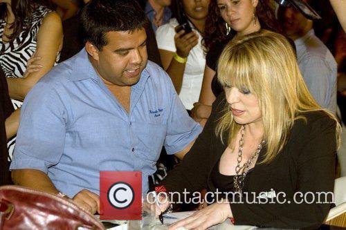 Latin singer Ednita Nazario  held an album...