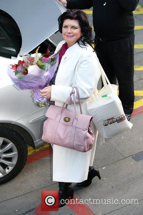 Scottish actress and comedienne Elaine C. Smith carrying...