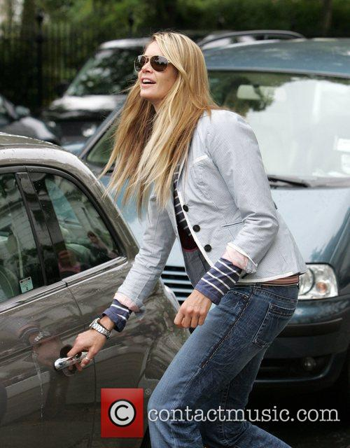 Elle Macpherson leaves her house to take her...
