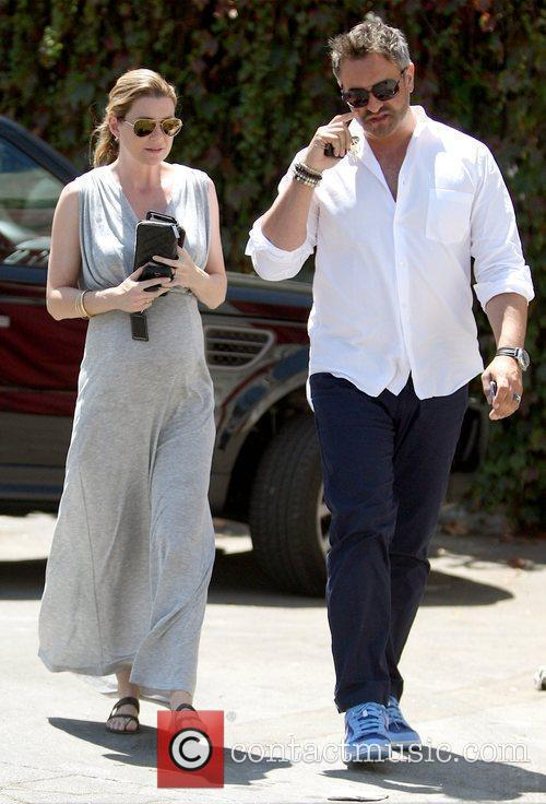 Ellen Pompeo showing off her baby bump while...