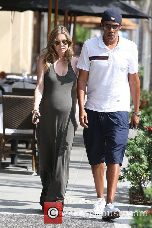 A heavily pregnant Ellen Pompeo and her husband...