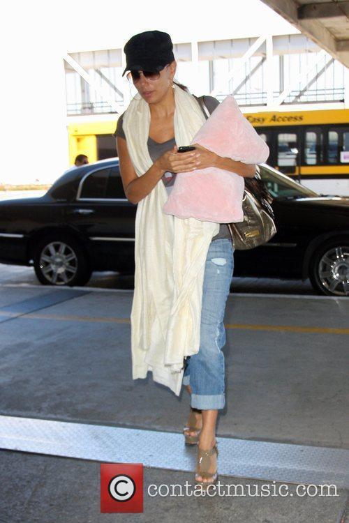 Eva Longoria-Parker arriving at LAX airport to catch...