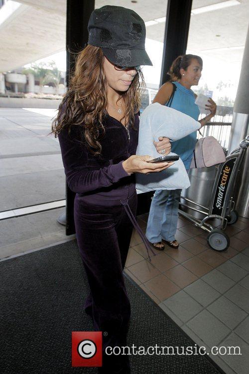 Eva Longoria Parker arriving at LAX airport to...