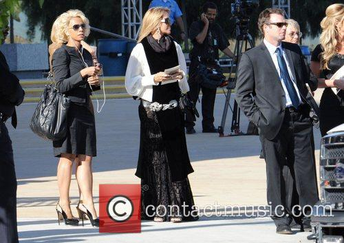 Guests attends the funeral service for actress Farrah...