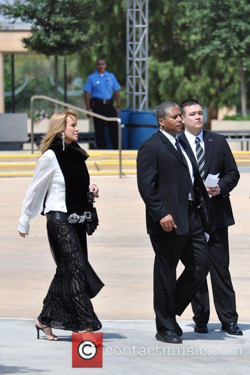 Guests arrive at the funeral services for actress...