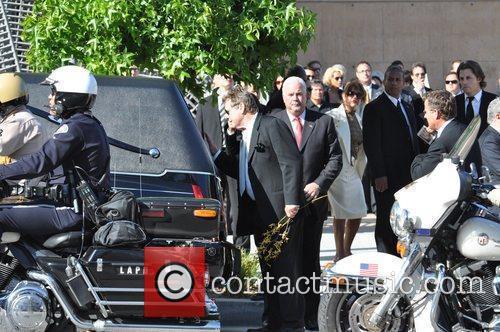 at the funeral service for actress Farrah Fawcett...