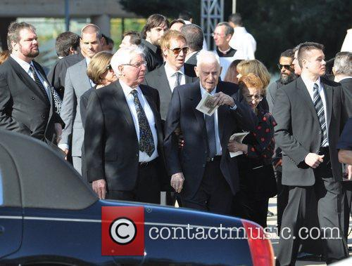 Guests at the funeral service for actress Farrah...