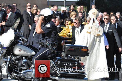 Ryan O'Neal at the funeral service for actress...
