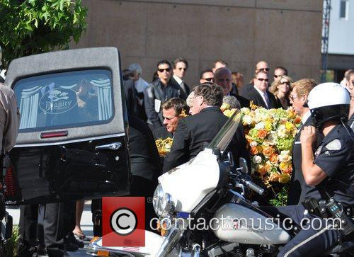 Ryan O'Neal and pall bearers at the funeral...