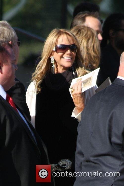 Guests attend the funeral service for actress Farrah...