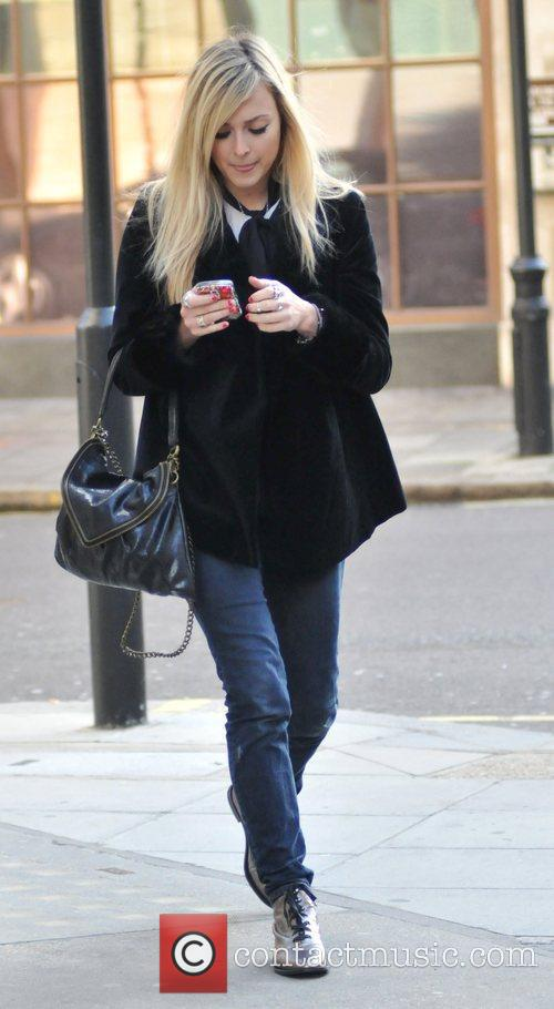 Leaving the Radio One studios after presenting her...
