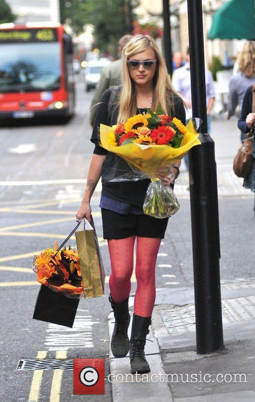 Carrying flowers and gifts while leaving the Radio...