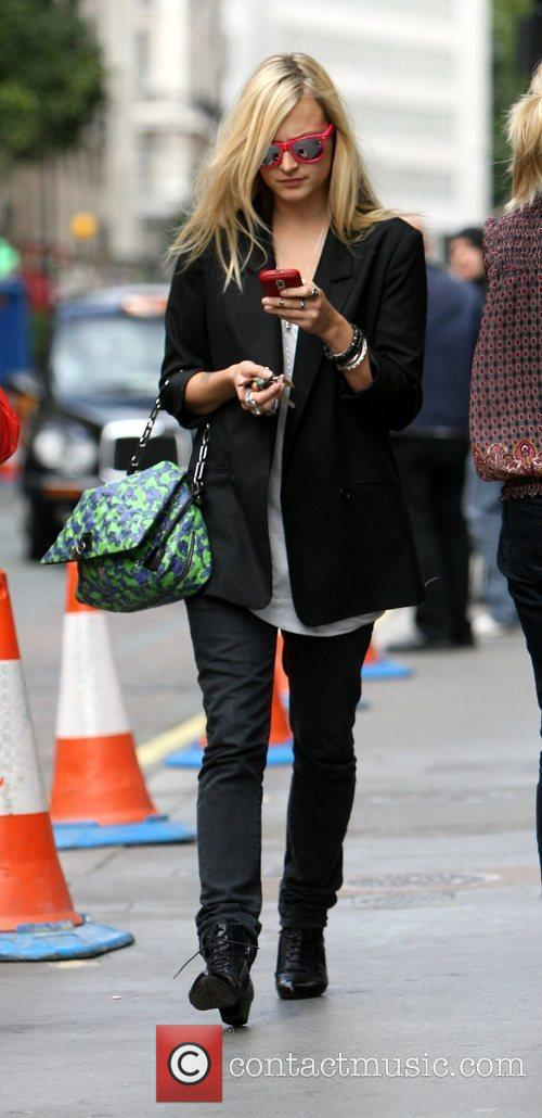 Fearne Cotton using her phone after leaving the...