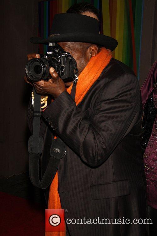 Ben Vereen holding a Nikon Camera Opening night...