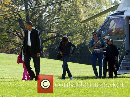 President Barack Obama  with his wife Michelle...