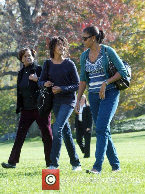 First Lady Michelle Obama  with her daughter...