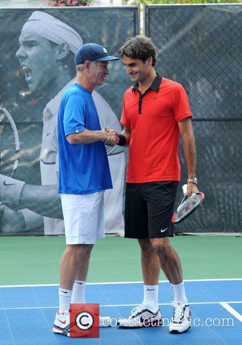John Mcenroe and Roger Federer 5