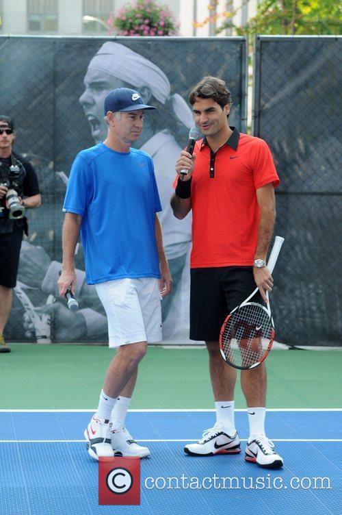 John Mcenroe and Roger Federer 4
