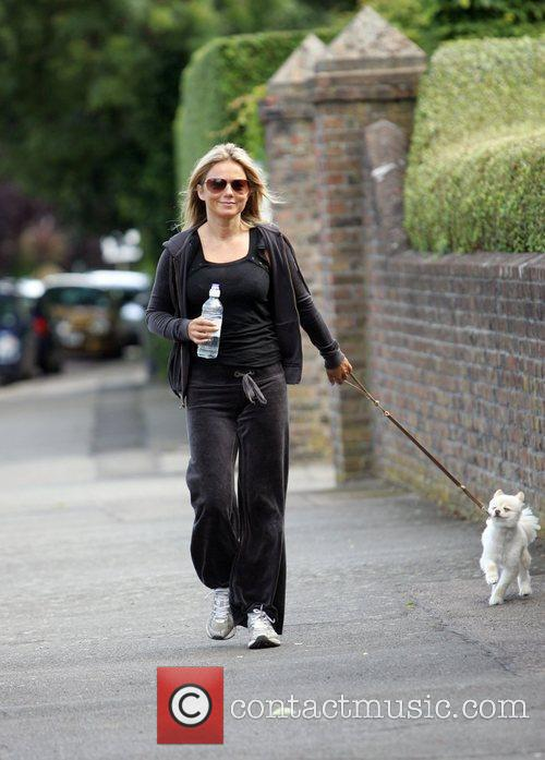 Takes her dog for a walk near her...