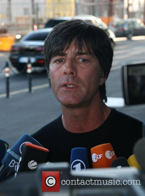 Head Coach Joachim Loew  and players from...