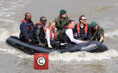 Sienna Miller arrives by boat to promote her...