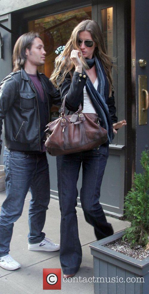 Supermodel Gisele Bundchen leaving a restaurant with a...