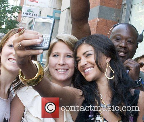 Jessica Szohr posing with fans The cast of...