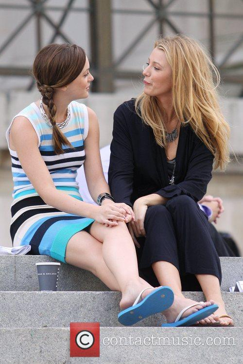 Leighton Meester and Blake Lively talk during a...