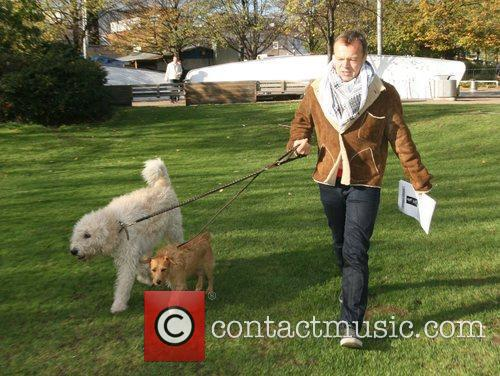 Walking his dogs near the London Studios
