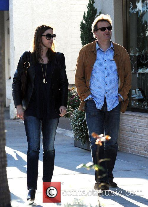 Greg Proops walks with his wife Jennifer Canaga...