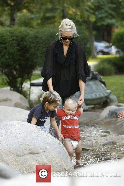 Gwen Stefani at Beverly Hills park playing with...
