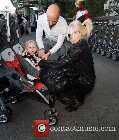 Gwen Stefani and Zuma Rossdale at LAX airport,...