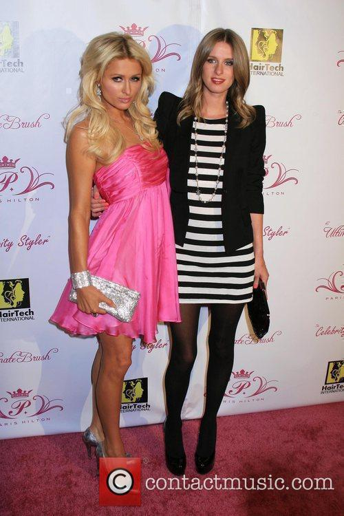 Paris Hilton with sister Nicky Hilton New Hairstyling...