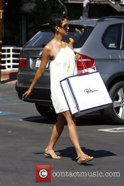 Seen returning to her car after shopping at...