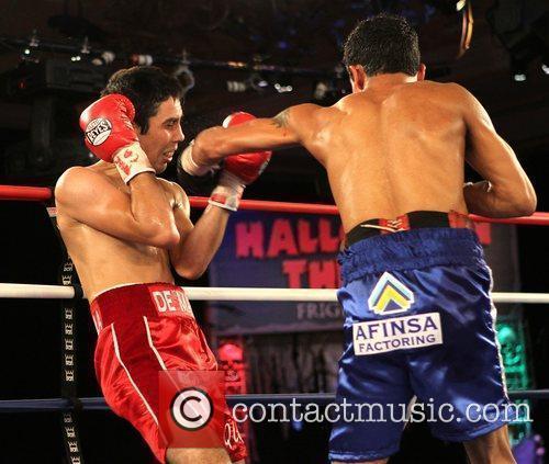 Antonio DeMarco and Jose Alfaro fight during Halloween...