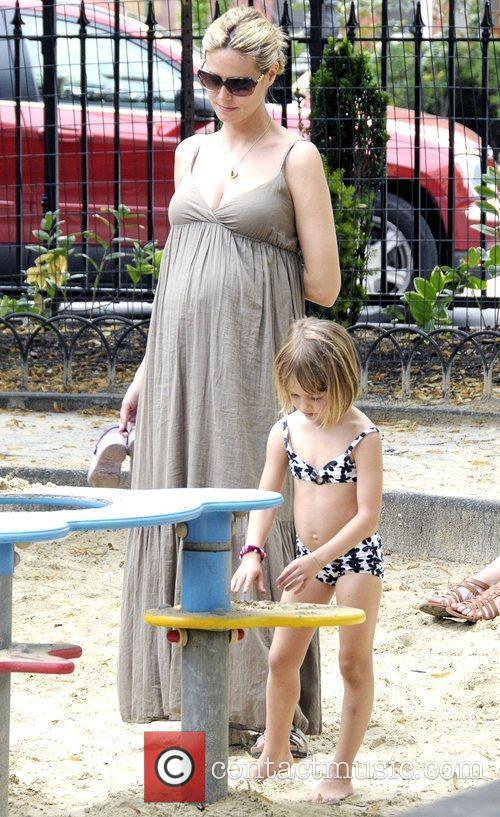 Heidi Klum with daughter Leni Klum playing at...