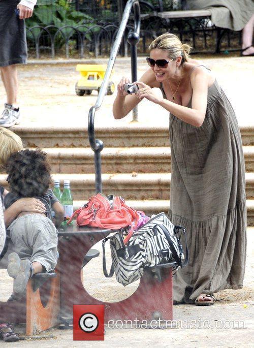 Heidi Klum taking photos of her son, Henry,...