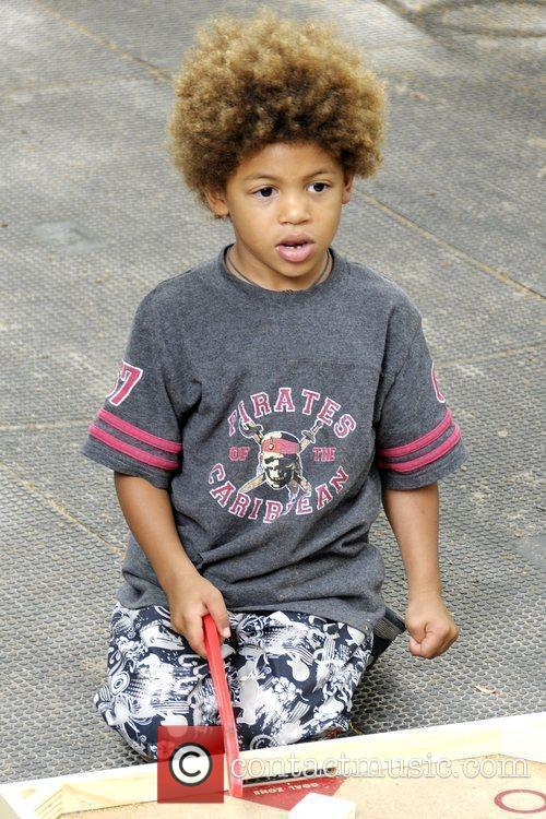 Heidi Klum's son Henry playing at a park...