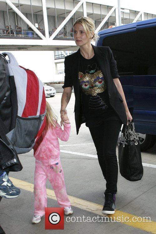 Heidi Klum says good bye to her husband...